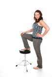 Woman with foot on stool Royalty Free Stock Photo