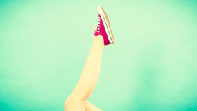 Woman foot up with red sneaker Royalty Free Stock Photography
