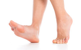 Woman foot on white Royalty Free Stock Photography