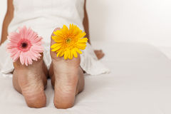 Woman Foot With Flowers Stock Photos