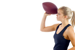 Woman with Football. Beautiful blond girl throwing the football isolated over white stock photo