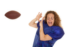 Woman football player afraid to catch ball Stock Images