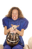 Woman football player dog in helmet choke Stock Images