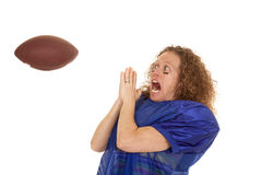 Woman football player scared of ball Royalty Free Stock Image