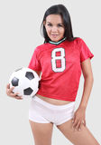 Woman and football Royalty Free Stock Photography
