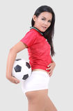 Woman and football stock photo