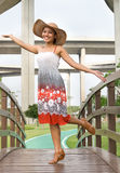 Woman on footbridge Stock Photography