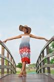 Woman on footbridge Stock Images