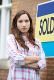 Woman Forced To Sell Home Through Financial Problems. Unhappy Woman Forced To Sell Home Through Financial Problems Royalty Free Stock Photo