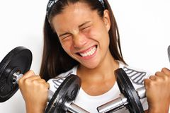 woman forcing exercise Royalty Free Stock Image