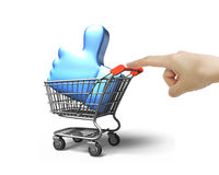 Woman forefinger pushing shopping cart with thumb up inside Royalty Free Stock Images
