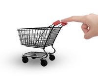 Woman forefinger pushing small empty shopping cart side view Royalty Free Stock Photo