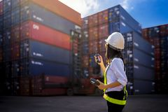 Woman Foreman control loading Containers box Stock Photo