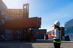 Woman Foreman control loading Containers box Stock Photography