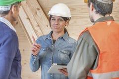 Woman foreman instructing layman Stock Photo