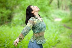 Woman in forest Royalty Free Stock Image