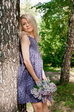 Woman in the forest. Blonde calm woman in the spring forest Stock Photo
