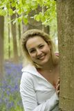 Woman in forest. Young woman in a bluebell wood Stock Photography