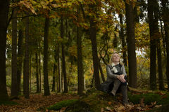 Woman in forest with autumn colors Royalty Free Stock Photos