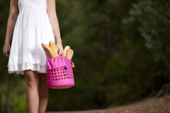Woman at the forest with bread in the basket Royalty Free Stock Photography