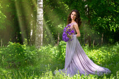 Woman in the forest version with sunrays Stock Photography