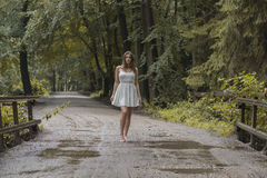 Woman in the forest with a white dress stock images
