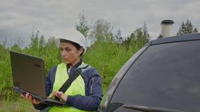 Woman forester drinking take away coffee near car