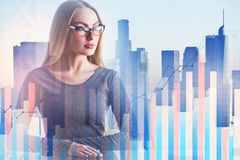 Woman with forex chart. Attractive young european woman on abstract city background with business forex chart. Finance, trade and analysis concept. Double Stock Photos
