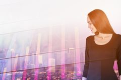 Woman with forex chart. Portrait of attractive young european businesswoman standing on abstract city background with forex chart. Finance concept. Double Royalty Free Stock Photo
