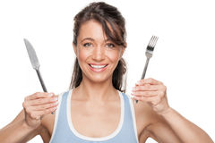 Woman with fork and knife Stock Photography