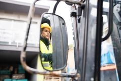 Free Woman Forklift Truck Driver In An Industrial Area. Royalty Free Stock Image - 105464476
