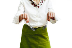 Woman with forks. On plain white background royalty free stock image