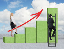 A woman in formal clothes is going up through a green bar chart, while a man has found a shortcut how to reach the final point of Royalty Free Stock Images