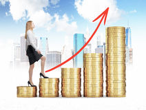 A woman in formal clothes is going up to the stairs which are made of golden coins. A sketch of New York on background. A red arro Stock Image