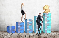 A woman in formal clothes is going up using a stairs which are made of houses, while a man has found a shortcut how to reach a fin Royalty Free Stock Photos