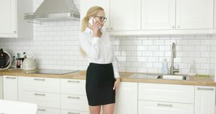 Woman in formal clothing talking phone stock video footage