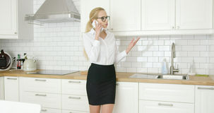 Woman in formal clothing talking phone Stock Images