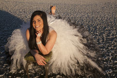 Woman formal dress ice barefoot lay smile Stock Photography