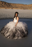 Woman formal dress ice mountain sit serious Royalty Free Stock Photos