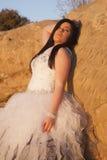Woman formal rocks lean back Royalty Free Stock Photo