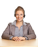 Woman in formal suit and headset Stock Images