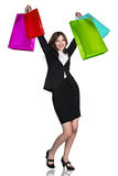 Woman in formal wear with colorful packages Royalty Free Stock Photo