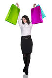 Woman in formal wear with colorful packages Stock Image