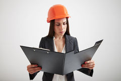 Woman in formal wear familiarize with the materials in folder Royalty Free Stock Photo