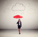 Woman in formal wear holding red umbrella Royalty Free Stock Image