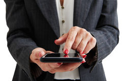 Woman in formal wear holding smartphone Stock Images