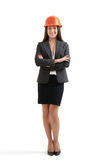 Woman in formal wear and orange hardhat Royalty Free Stock Photography