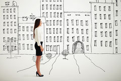 Woman in formal wear over drawing cityscape Royalty Free Stock Images