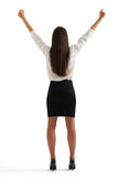 Woman in formal wear raising her hands up Royalty Free Stock Photo