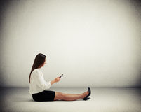 Woman in formal wear sitting on the floor Royalty Free Stock Photography